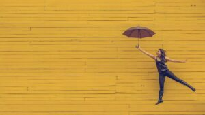 Pam Bartlett, Alexander Technique Leaping Woman with umbrella