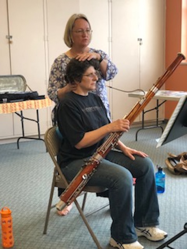 Pam Bartlett, Alexander Technique helping a seated bassoonist with posture