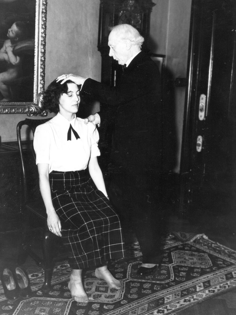 Vintage photo of FM Alexander helping a seated woman with posture